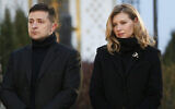 In this file photo taken on Saturday, Nov. 23, 2019, President Volodymyr Zelenskiy and his wife Olena pay tribute at a monument to victims of the Great Famine in Kyiv, Ukraine (AP Photo/Efrem Lukatsky)