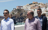Greek Prime Minister Kyriakos Mitsotakis, left, visits the town of Fira in Satorini, June 13, 2020. (Dimitris Papamitsos/ Greek Prime Minister's Office via AP)