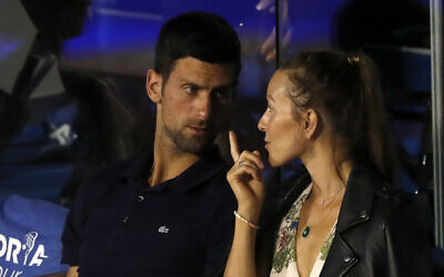Serbia's Novak Djokovic, left, speaks with his wife Jelena during a final tennis match of the Adria Tour charity tournament, between Austria's Dominic Thiem and Serbia's Filip Krajinovic, in Belgrade, Serbia, June 14, 2020. (AP Photo/Darko Vojinovic)