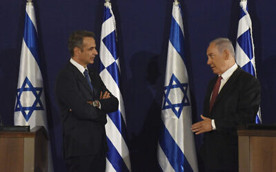 Prime Minister Benjamin Netanyahu, right, and Greek Prime Minister Kyriakos Mitsotakis give joint statements in Jerusalem, June 16, 2020. (Debbie Hill, UPI Pool via AP)