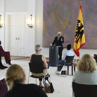 Federal President Frank-Walter Steinmeier, center, talks during a discussion round on experiences of racism and discrimination at Bellevue Palace, Berlin, June 16, 2020 (Annegret Hilse/Pool Photo via AP)