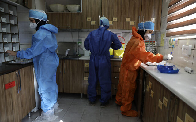 In this Tuesday, June 16, 2020, photo, nurses prepare medicines for COVID-19 patients at the Shohadaye Tajrish Hospital in Tehran, Iran. (AP Photo/Vahid Salemi)