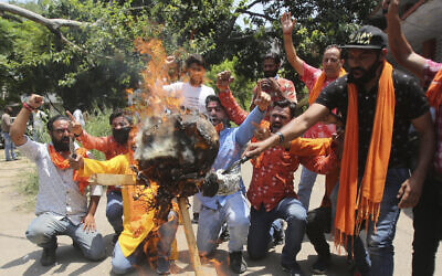 Activists of Rashtriya Bajrang Dal burn an effigy of Chinese President Xi Jinping during a protest against the Chinese government in Jammu, India, June 17, 2020. (AP Photo/Channi Anand)
