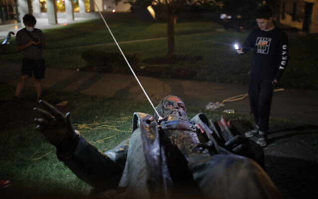 People film the only statue of a Confederate general, Albert Pike, in the nation's capital after it was toppled by protesters and set on fire in Washington, June 20, 2020 (AP Photo/Maya Alleruzzo)
