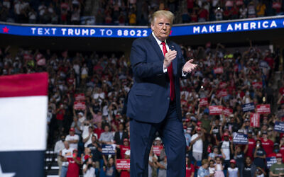 US President Donald Trump arrives on stage to speak at a campaign rally at the BOK Center, Saturday, June 20, 2020, in Tulsa, Okla. (AP Photo/Evan Vucci)