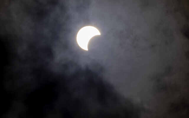 A partial solar eclipse is seen in Hefer Valley, Israel, June 21, 2020. (AP Photo/Ariel Schalit)