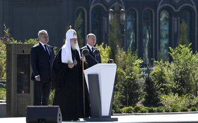 Russian Orthodox Church Patriarch Kirill, the Bishop of Moscow, center, delivers a speech as Russian President Vladimir Putin, right, and Russian Defense Minister Sergei Shoigu stand nearby at the dedication of the Main Cathedral of the Russian Armed Forces, June 22, 2020. (Alexei Nikolsky, Sputnik, Kremlin Pool Photo via AP)
