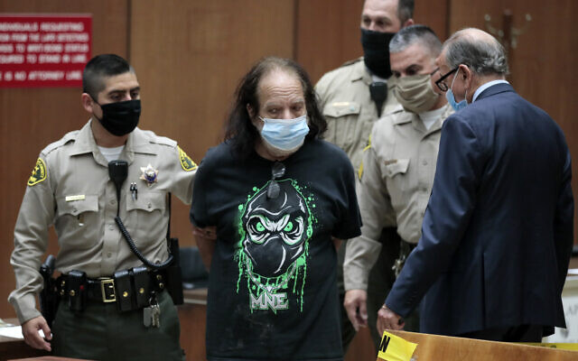 Adult film star Ron Jeremy, second left, with his attorney Stuart Goldfarb, right, makes his first appearance in Dept. 30 at Los Angeles Superior Court in Los Angeles, June 23, 2020 (Robert Gauthier/Los Angeles Times via AP, Pool)