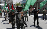 Hamas supporters march on the main road of Khan Younis City, Gaza Strip, on June 26, 2020. (AP Photo/Adel Hana)