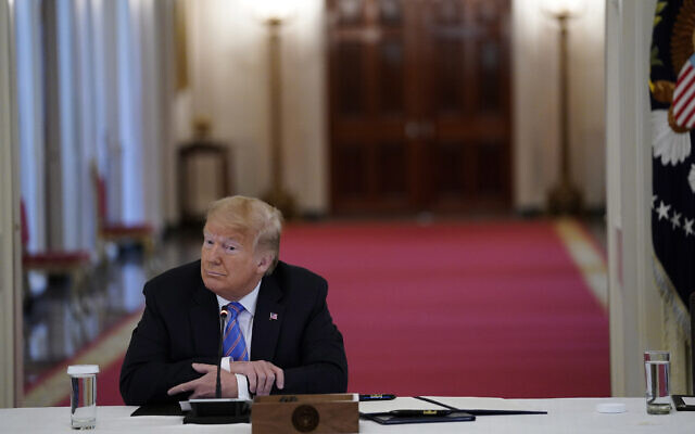 US President Donald Trump listens during a meeting with the American Workforce Policy Advisory Board, in the East Room of the White House, June 26, 2020, in Washington. (Evan Vucci/AP)