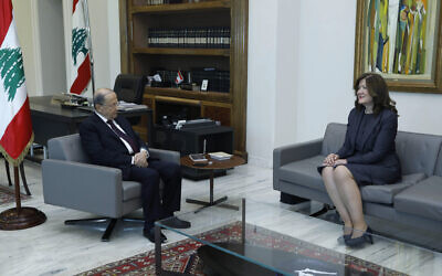 In this photo released on Thursday, June 11, 2020 by the Lebanese Government, President Michel Aoun, left, meets with U.S. Ambassador to Lebanon Dorothy Shea, at the Presidential Palace in Baabda, east of Beirut, Lebanon. (Dalati Nohra/Lebanese Government via AP)