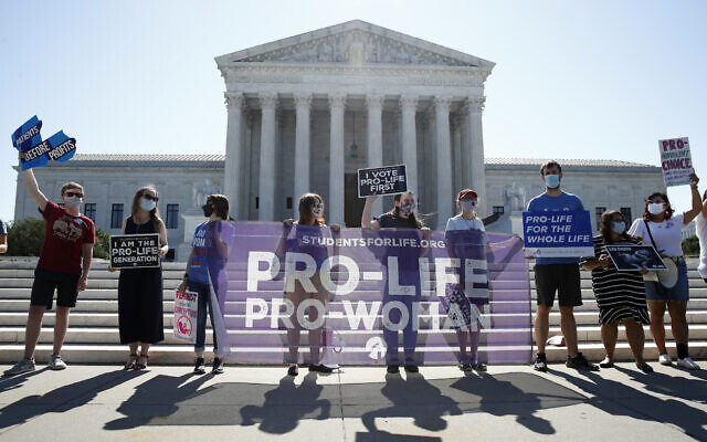 Anti-abortion protesters wait outside the Supreme Court for a decision, June 29, 2020, in Washington on the Louisiana case, Russo v. June Medical Services LLC. (AP Photo/Patrick Semansky)