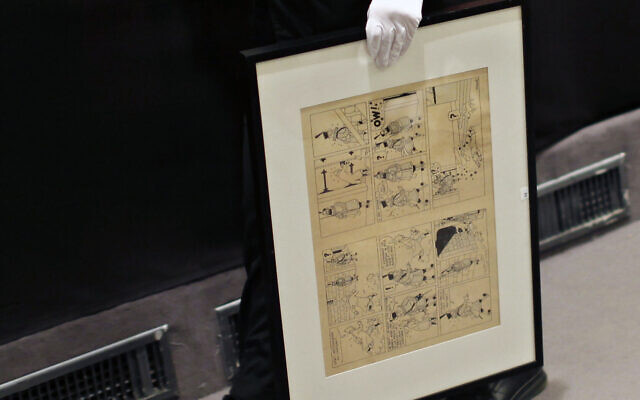 In this May 29, 2010 file photo, a porter holds an inked and water-painted original panel from the 1938 'King Ottokar's Sceptre' album drawn by Belgian creator Herge during the auction of rare memorabilia of Tintin, at the Drouot auction's house, in Paris  (AP Photo/Thibault Camus, File)