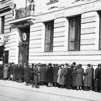 Austrian Jews line up outside the Polish consulate seeking documents in order to escape Nazified Austria, March 22, 1938.  (AP Photo)