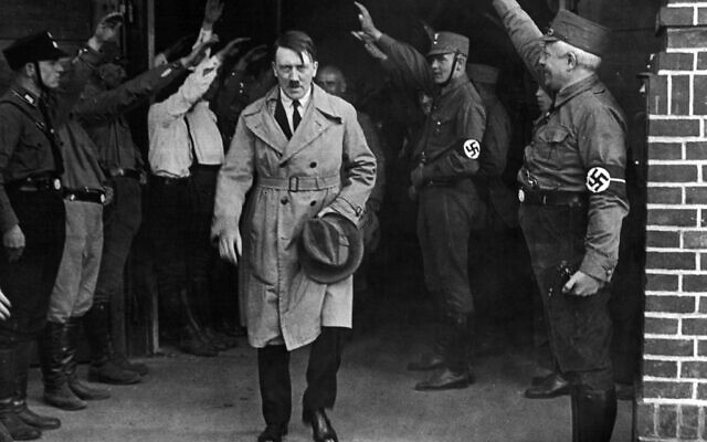 In this Dec. 5, 1931 photo, Adolf Hitler, leader of the National Socialists, is saluted as he leaves the party's Munich headquarters (AP Photo, File)