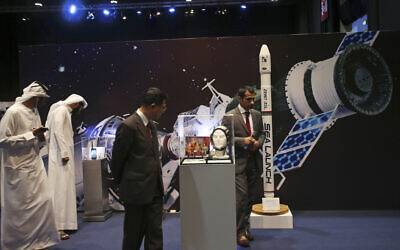 Emirati and other visitors visit the Space Museum during the launch of the UAE Space Agency strategic plan in Abu Dhabi, United Arab Emirates, May 25, 2015 (AP Photo/Kamran Jebreili)