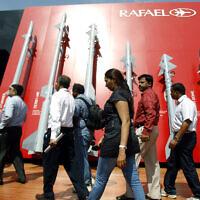 Visitors walk past a display of missiles by Israel's Rafael Advanced Defense Systems Ltd. on the second day of the Aero India 2013 at Yelahanka air base in Bangalore, India, February 7, 2013. (AP Photo/Aijaz Rahi)
