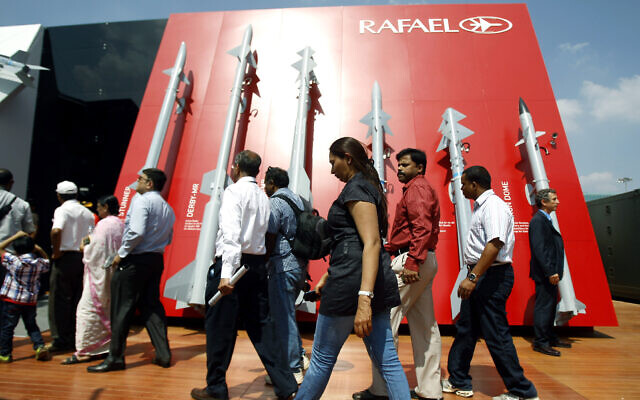 Visitors walk past a display of missiles by Israel's Rafael Advanced Defense Systems Ltd. on the second day of the Aero India 2013 at Yelahanka air base in Bangalore, India, February 7, 2013. (AP Photo/Aijaz Rahi)
