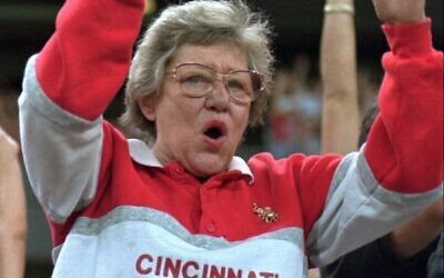 Former Cincinnati Reds owner Marge Schott does the wave during a game at Riverfront Stadium, September 1, 1995, in Cincinnati. (AP Photo/Tom Uhlman)