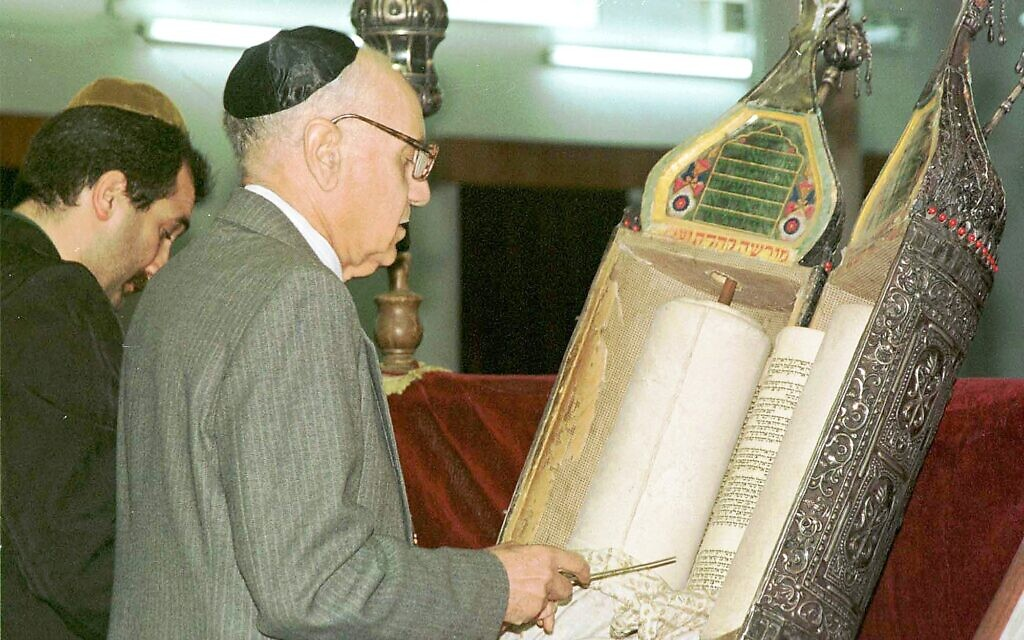 In this 1998 file photo, Tawfiq Safeer prepares for prayer in the synagogue of Baghdad, Saturday, March 21, 1998. (AP Photo/Jassim Mohammed)