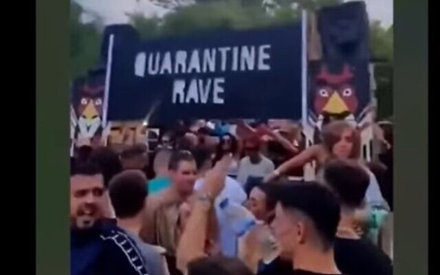 People defy lockdown orders to attend a rave near Manchester in the UK on June 13 2020 (Screencapture/YouTube)