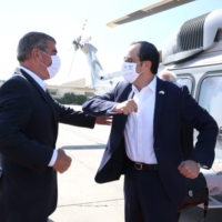 Foreign Minister Gabi Ashkenazi (L) greeting his Cypriot counterpart Nikos Christodoulides at Ben Gurion Airport, on June 23, 2020. (Foreign Ministry/courtesy)