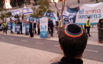 Illustrative: Religious Jewish activists protest same-sex parenting and LGBTQ families, across from LGBTQ advocates in Tel Aviv, December 16, 2018. (Tomer Neuberg/Flash90 )