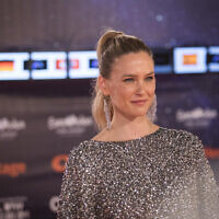 Model and host of the 2019 Eurovision Song Contest, Bar Refaeli, poses on the Orange Carpet, during the opening event, at Habima Square in Tel Aviv on May 12, 2019 (Hadas Parush/Flash90)