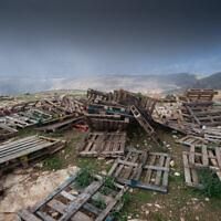 A bunch of wooden pallets in the Jordan Valley on February 2, 2020. (Yaniv Nadav/FLASH90)
