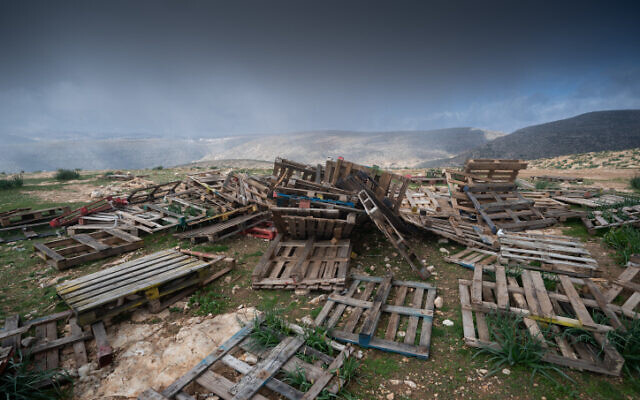 A bunch of wooden pallets in the Jordan Valley on February 2, 2020. (Yaniv Nadav/FLASH90)