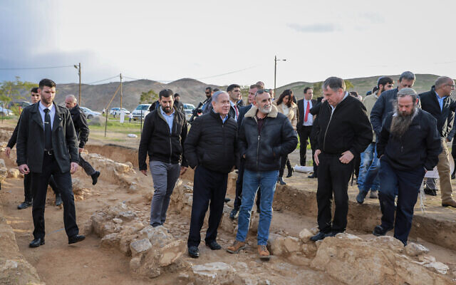 Prime Minister Benjamin Netanyahu (center left) and Yesha Council chairman David Elhayani seen during a tree planting event for the Jewish holiday of Tu Bishvat, in the West Bank settlement of Mevo'ot Yericho, in the Jordan Valley on February 10, 2020.  (Flash90)
