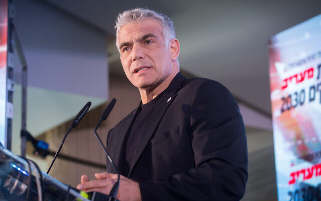 MK Yair Lapid speaks at the Maariv newspaper conference in Herzliya, on February 26, 2020. (Miriam Alster/Flash90)
