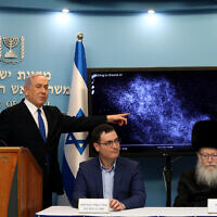Prime Minister Benjamin Netanyahu, left, then-health minister Yaakov Litzman, right, and Health Ministry Director General Moshe Bar Siman-Tov at a press conference about the coronavirus at the Prime Minister's Office in Jerusalem on March 11, 2020. (Flash90)