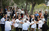 A couple celebrates their wedding at a public park in Efrat, March 15, 2020. (Gershon Elinson/Flash90)