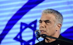 MK Yair Lapid speaks during a protest against Prime Minister Benjamin Netanyahu calling on him to quit, at Rabin Square in Tel Aviv on April 19, 2020. (Tomer Neuberg/Flash90)