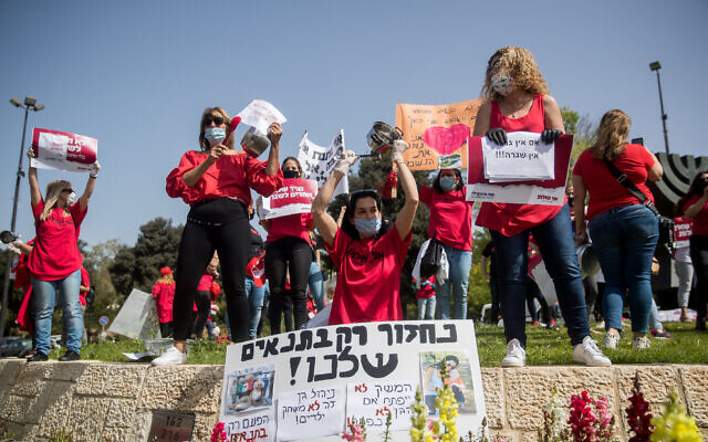 Self-employed people and kindergarten owners participate in a rally calling for financial support from the Israeli government in Jerusalem, on April 19, 2020 (Yonatan Sindel/Flash90)