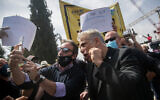 MK Yair Lapid arrives at a rally of self-employed and kindergarten owners calling for financial support from the government outside the Knesset in Jerusalem, on April 19, 2020 (Yonatan Sindel/Flash90)
