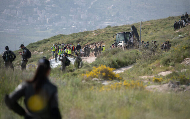 "Illustrative: Israeli border police officers seen during the demolishing of six illegally built structures at the outpost of ""Komi Ori"", outside the Jewish settlement of Yitzhar, in the West Bank, April 22, 2020. (Sraya Diamant/Flash90)"