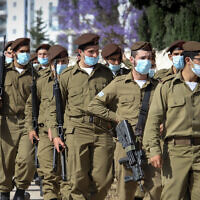 Illustrative: Soldiers from the Golani Brigade wearing face masks, on May 12, 2020 (Yossi Aloni/Flash90)
