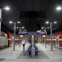 A man walks by trains at Yitzhak Navon station in Jerusalem on May 14, 2020 (Olivier Fitoussi/Flash90)