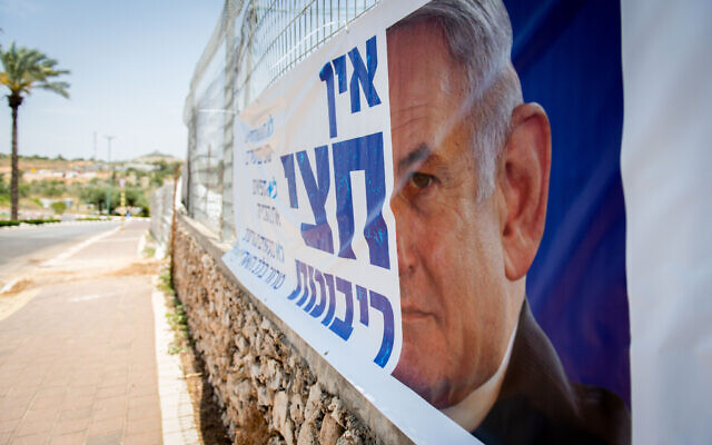 """A sign that reads """"there is no half sovereignty,"""" displayed in the northern West Bank settlement of Karnei Shomron on June 4, 2020. (Sraya Diamant/Flash90)"""