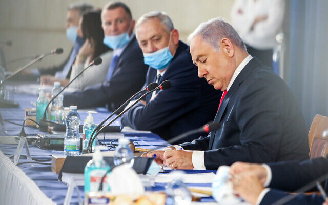 Prime Minister Benjamin Netanyahu, right, and Defense Minister Benny Gantz lead a weekly cabinet meeting, at the Foreign Ministry in Jerusalem on June 7, 2020. (Marc Israel Sellem)