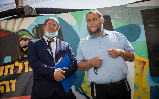 Lehava chairman Benzi Gopstein, right, and his attorney Itamar Ben Gvir, left, arrive at the Jerusalem Magistrate's Court, June 8, 2020. (Yonatan Sindel/Flash90)