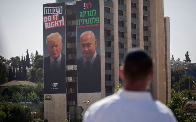 """A large billboard depicting US President Donald Trump and Prime Minister Benjamin Netanyahu, as part of a new campaign by the Yesha Council with the text """"no to a Palestinian state"""" and """"sovereignty, do it right"""" in Jerusalem on June 10, 2020. (Yonatan Sindel/Flash90)"""