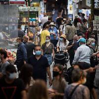 People shop for food at the Mahane Yehuda Market in Jerusalem on June 17, 2020. (Yonatan Sindel/Flash90)