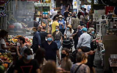 People shop for food at the Mahane Yehuda Market in Jerusalem on June 17, 2020. (Yonatan Sindel/Flash90)