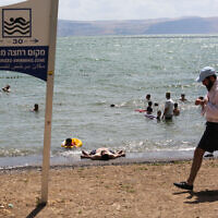Israelis enjoy the beaches of the Sea of Galilee, June 19, 2020 (David Cohen/Flash90)