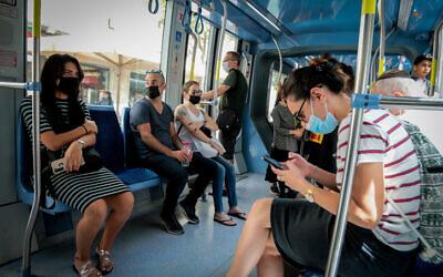 Passengers ride on Jerusalem's light rail on June 21, 2020. (Yossi Zamir/Flash90)