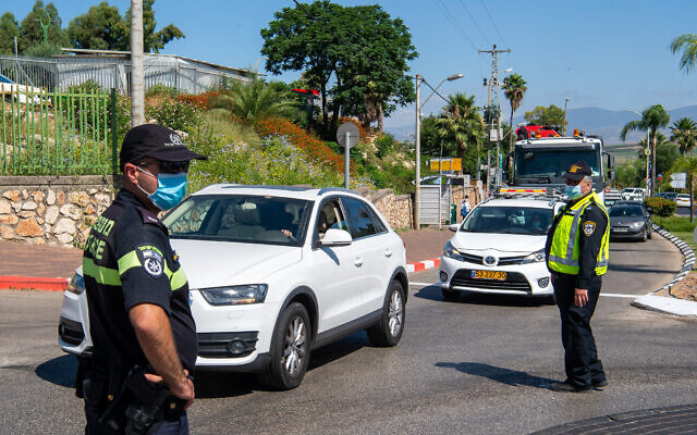 Police officers at the entrance to a neighborhood in Tiberias on June 24, 2020. (Basel Awidat/Flash90)