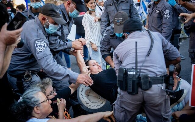 Police remove a protester during a protest against Prime Minister Benjamin Netanyahu outside the Prime Minister's Residence in Jerusalem, on June 26, 2020. (Yonatan Sindel/Flash90)